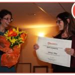 Monica Dogi riceve il premio di Merito e Riconoscenza