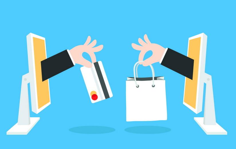 Mani che escono da schermi PC che scambiano carta di credito con sacchetto